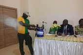 A GTHI volunteer demonstrates how to use an LPG cylinder