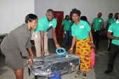 Training people how to use the gas cookers at the launch of Project Mama Put